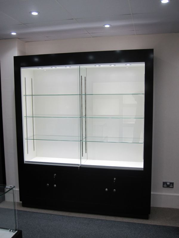 Simon Mozley asked Idea Showcases to design a Trophy Cabinet to fit in the narrow corridor outside his office and entrance.